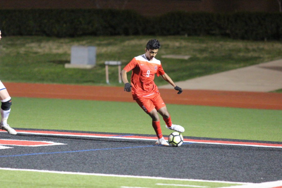 Coppell junior Tom Vazhekatt makes a pass during the game against Flower Mound on Feb. 8. The Cowboys won 2-1 against the Jaguars.