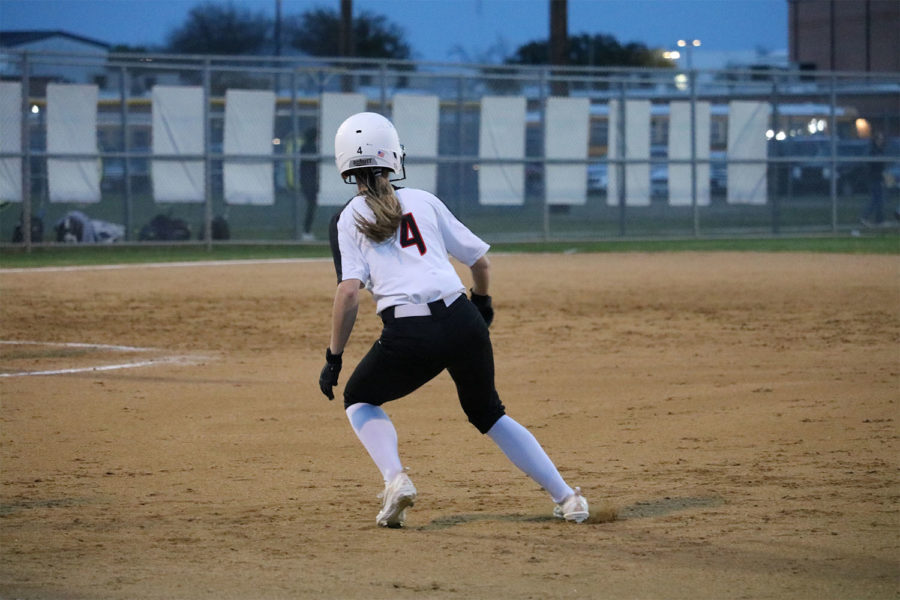Coppell junior Olivia Reed first base looks to steal second during fourth inning at Coppell ISD Baseball/Softball Complex on Friday. The Cowgirls lost to Jaguars, 3-2.