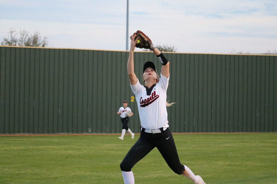Coppell sophomore Sydney Ingle shortstop  catches a pop fly during third inning at Complex Coppell ISD Baseball/Softball Complex on Friday. The Cowgirls lost to Jaguars, 3-2.
