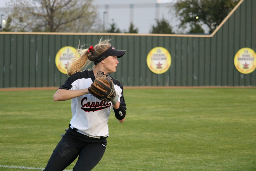 Coppell sophomore Sydney Ingle shortstop prepares to throw during third inning at CHS9 Complex on March 22. The Cowgirls lost to Jaguars, 2-3.