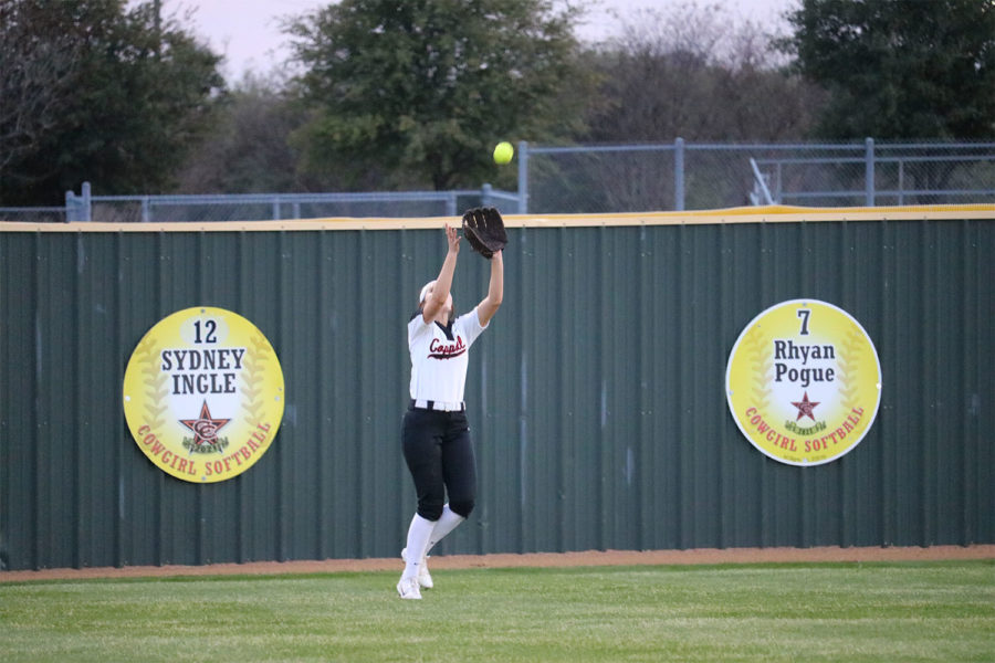 Coppell junior Rylee Anderson right-fielder catches a pop fly during fifth inning at Coppell ISD Baseball/Softball Complex on Friday. The Cowgirls lost to Jaguars, 3-2.