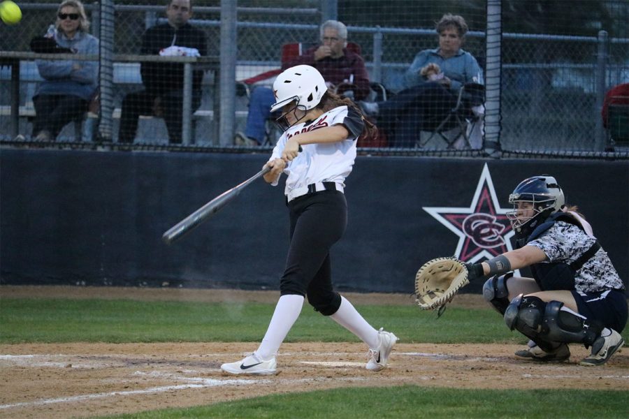 Coppell senior Ari Frigueroa  catcher hits the ball during fourth period at Coppell ISD Baseball/Softball Complex on Friday. The Cowgirls lost to Jaguars, 3-2.