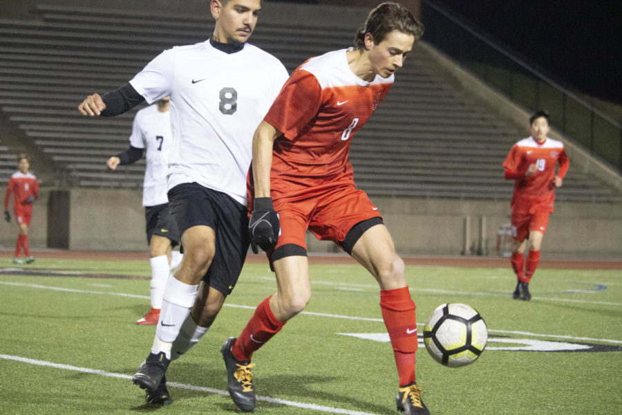 Bailey Lai Coppell senior forward Joe Ruedi steals the ball during the game on March 5 against Irving at Buddy Echols Field. The Cowboys won, 4-0, against the Tigers.