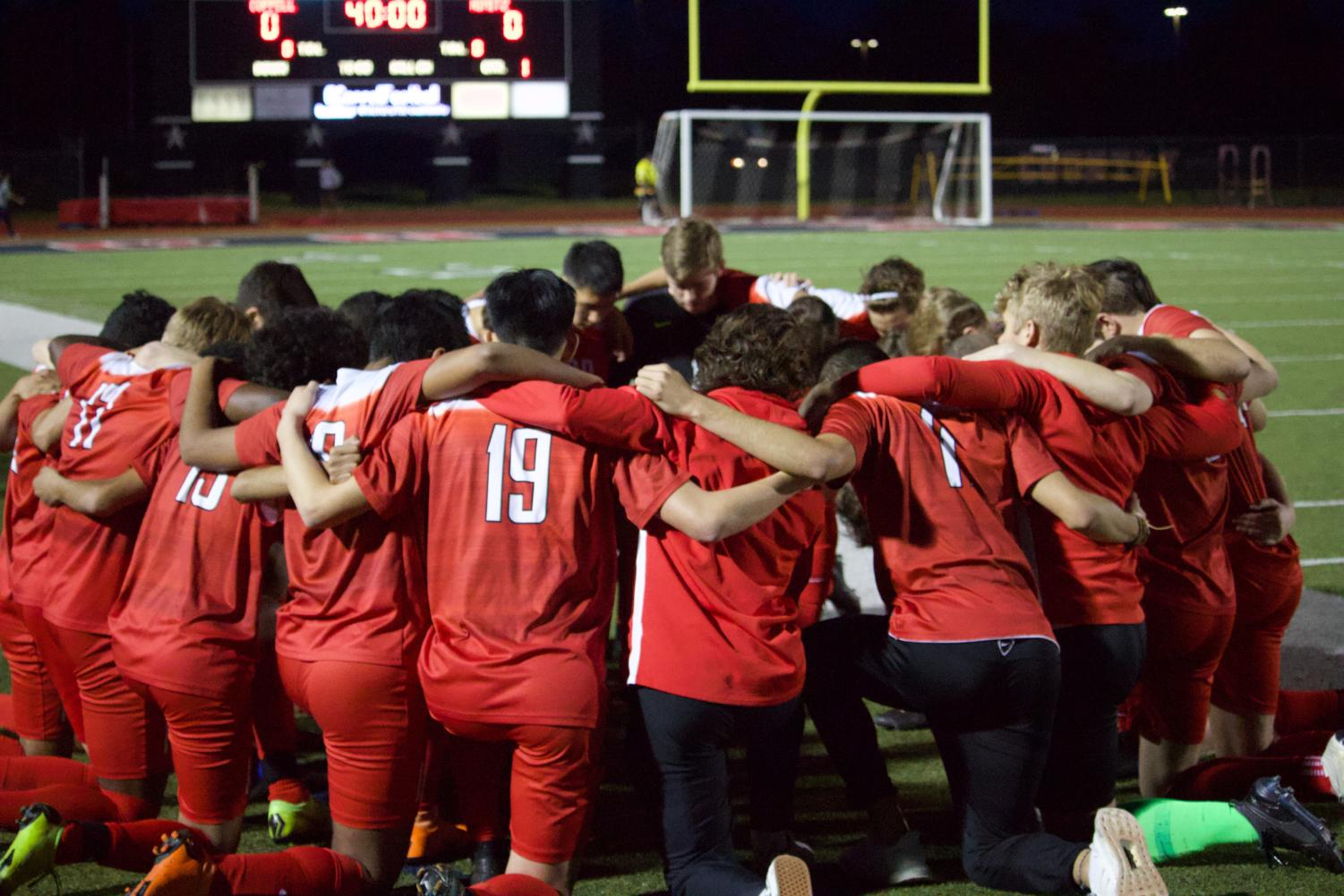 The Coppell boys soccer team huddles before the Irving Nimitz on March 22 to exchange words of encouragement at Buddy Echols Field. The Cowboys plays its second Class 6A Region I bi-district playoffs match against Grand Prairie at Mustang-Panther Stadium on Tuesday at 8 p.m.