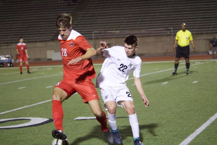 Coppell senior midfielder Jeremy Basso fights for possession as he dribble up field on Friday at Buddy Echols Field. The Coppell Cowboys defeated Irving Nimitz, 4-1.