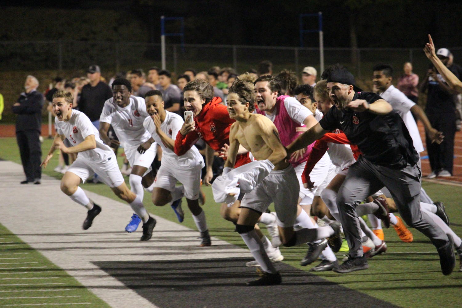 +The+Coppell+boys+soccer+team+celebrates+after+senior+goalie+Austin+Simigian+blocks+Denton+Guyer%E2%80%99s+Penalty+kick+to+steal+the+victory+for+the+Cowboys+at+Falcon+Stadium+in+Lake+Dallas.+After+a+scoreless+regulation+and+two+overtime+periods%2C+Coppell+won%2C++0-0+%284-3%29%2C+in+the+Class+6A+Region+I+bi-district+match
