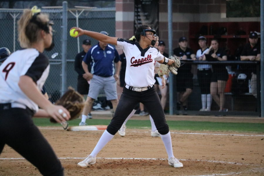 Coppell senior Nora Rodriguez pitches against Flower Mound during the first inning at Coppell ISD Baseball/Softball Complex on Friday. The Cowgirls lost to the Jaguars, 3-2.