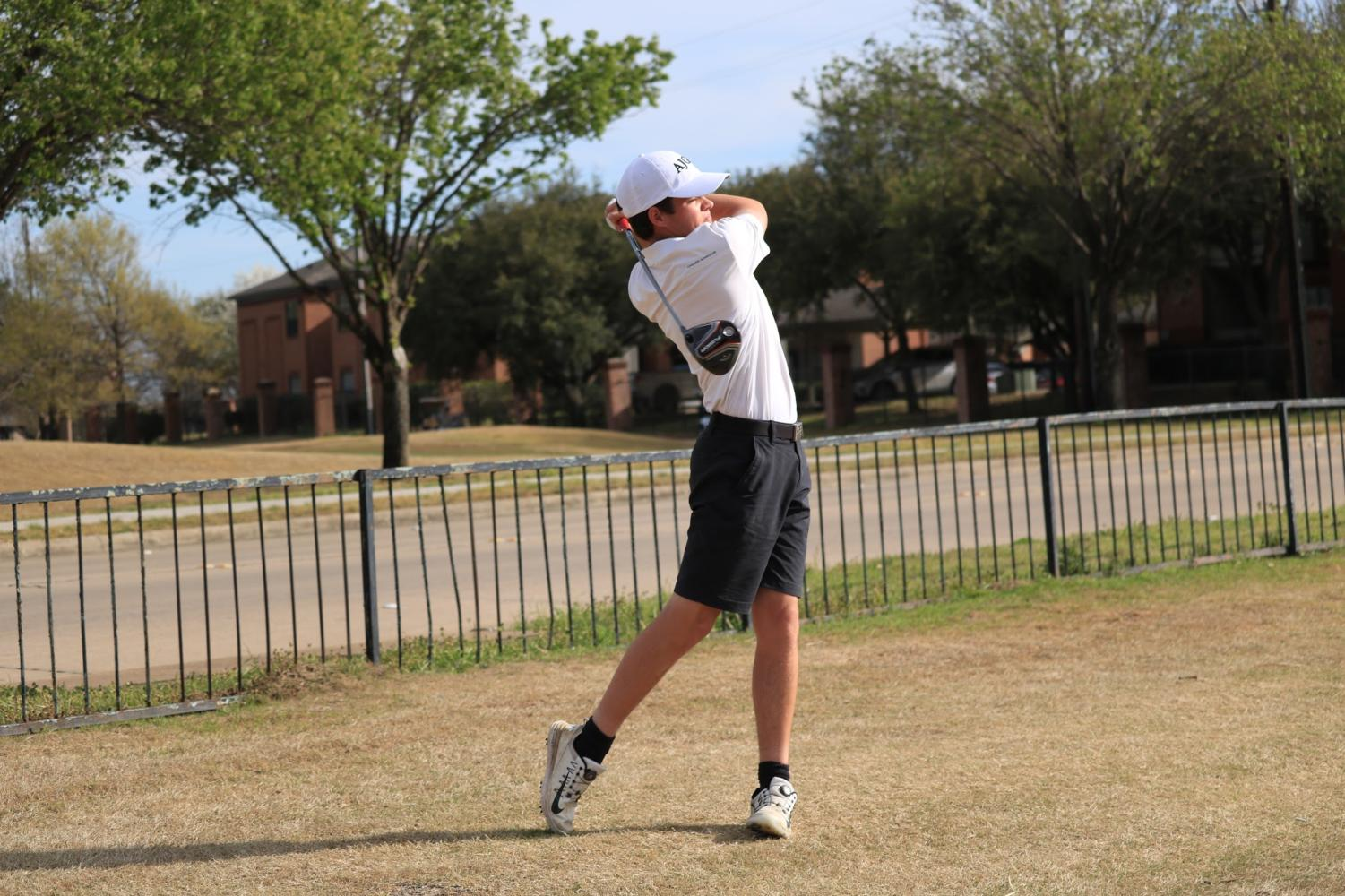 Coppell junior Ryan Schweitzer works on his drive after practice at the Riverchase Golf Course on March 21. Schweitzer joined the CHS junior varsity golf team his freshman year and has since developed his passion for the sport and moved up to  the varsity team.