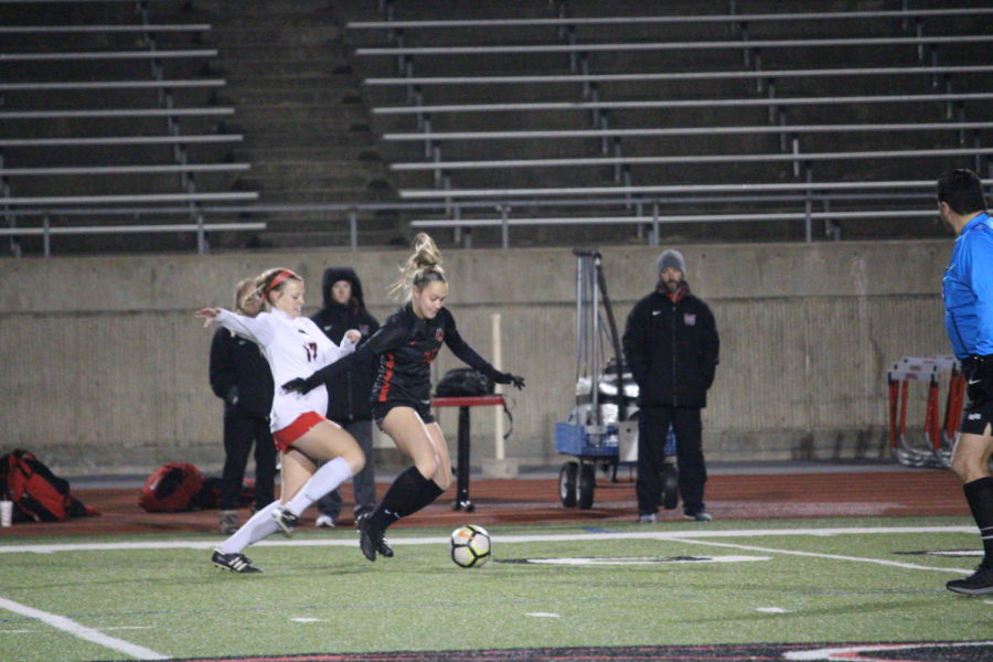 Coppell junior forward Micayla Weathers keeps her feet on the ball to pass it to her teammate on Friday at the Buddy Echols Field. The Cowgirls defeated the Lady Marauders, 2-1.