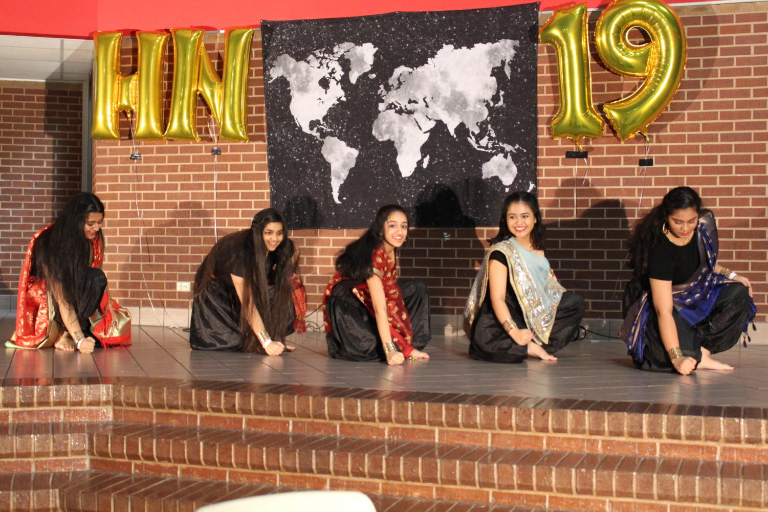 Coppell High School Club Rhythm (left to right) junior Srija Uppu, junior Nupur Rishi, sophomore Maybelle Abraham, junior Shreya Bandopadhyay and sophomore Nikitha Gokaraju  perform a Bollywood melody on Friday night at Coppell High School in the commons. Heritage Night celebrates cultural diversity and brings students together to enjoy this distinction.