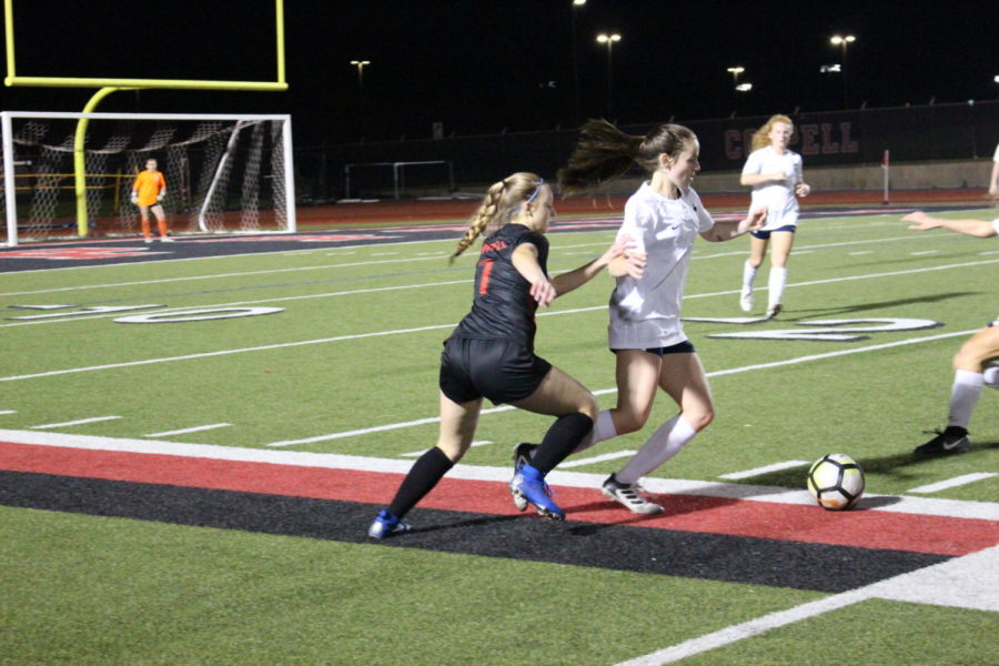Coppell junior midfielder Alyssa Roemer attempts to get the ball back in the Cowgirls' possession at Buddy Echols Field on Tuesday. The Cowgirls won, 2-1, against Jaguars in their last home game.
