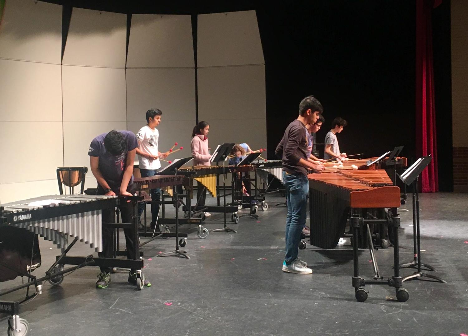 Coppell High School percussionists prepare for their rehearsal for Purely Rhythmic, an annual show and fundraiser on March 7. The show starts at 7 p.m., and admission is $8 for adults and $5 for students.