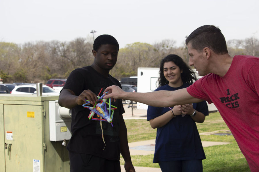 Students testing egg contraptions to examine force, impact