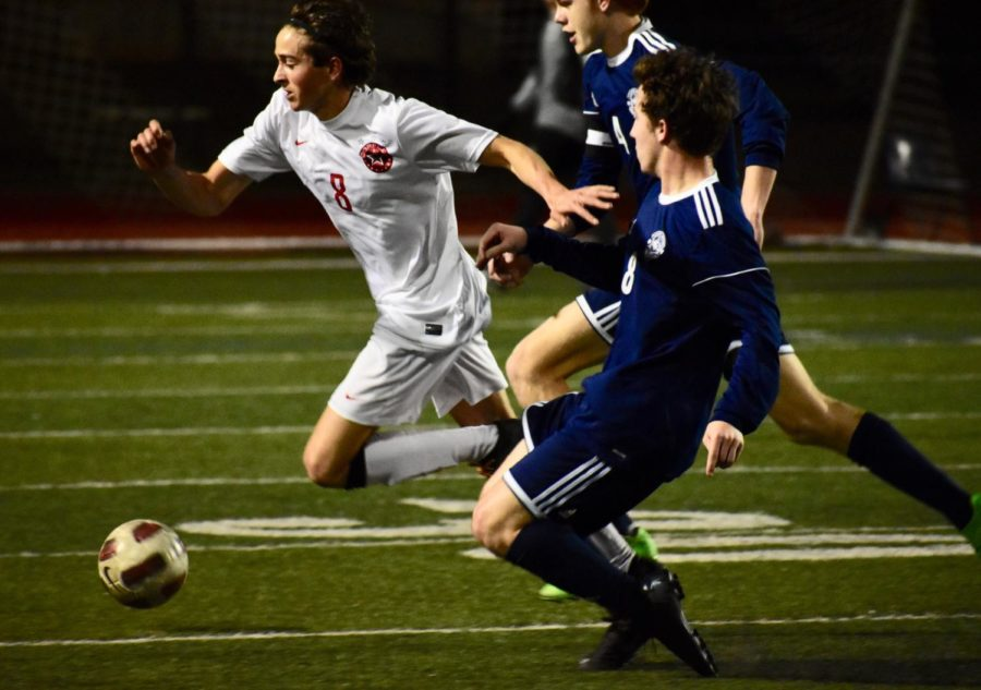 Coppell senior forward Joe Ruedi chases after the ball during the first half of the game against Flower Mound on Tuesday at the Neal Wilson Athletic Stadium. The Cowboys lost, 2-1, and play Irving Nimitz tomorrow night at 7:30 p.m. at Buddy Echols Field.