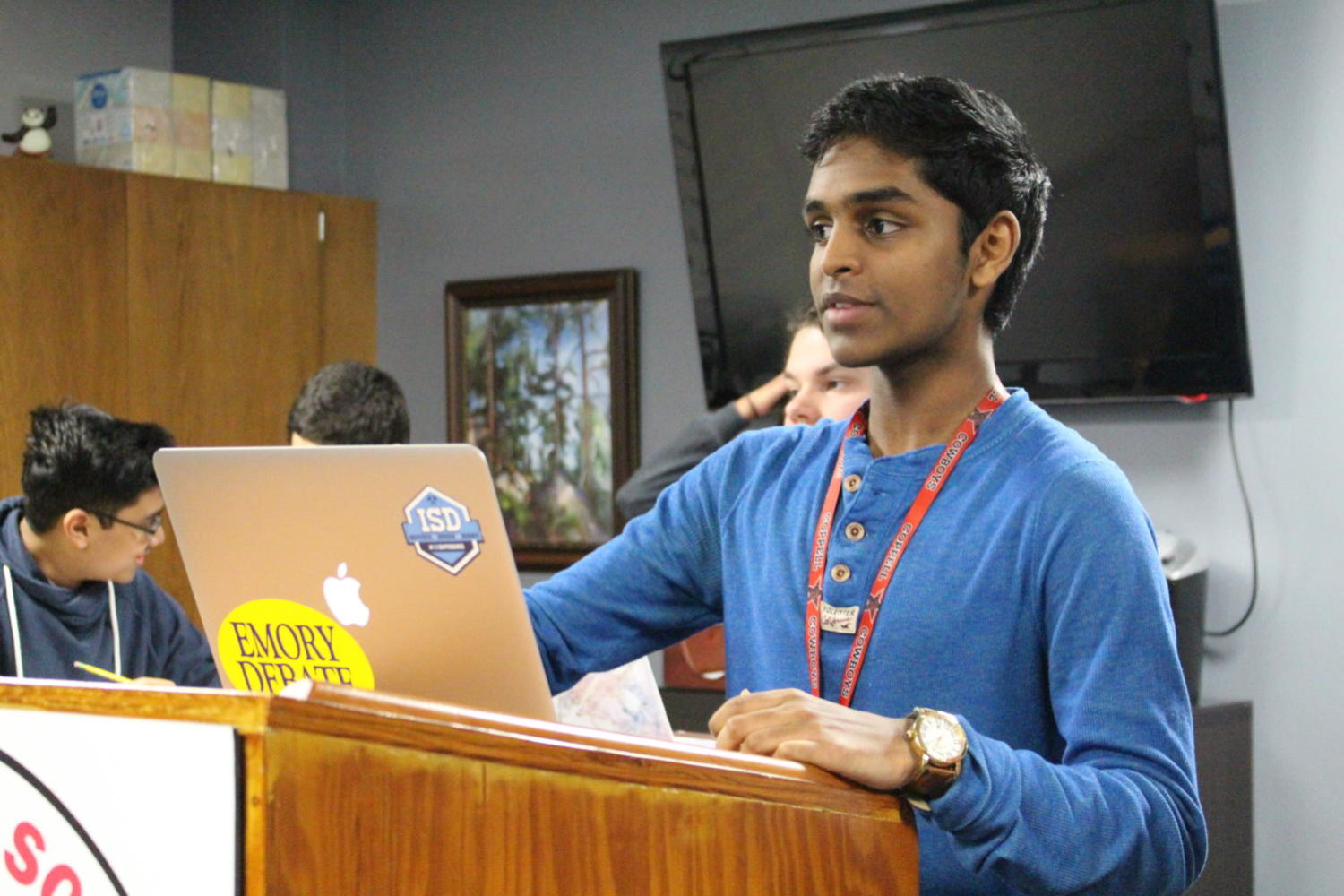 Coppell High School junior Bhavik Reddy presents his argument supporting vaccines during CHS debate coach Dr. Jason Sykes' seventh period class. Reddy has been in debate since his freshman year of high school.