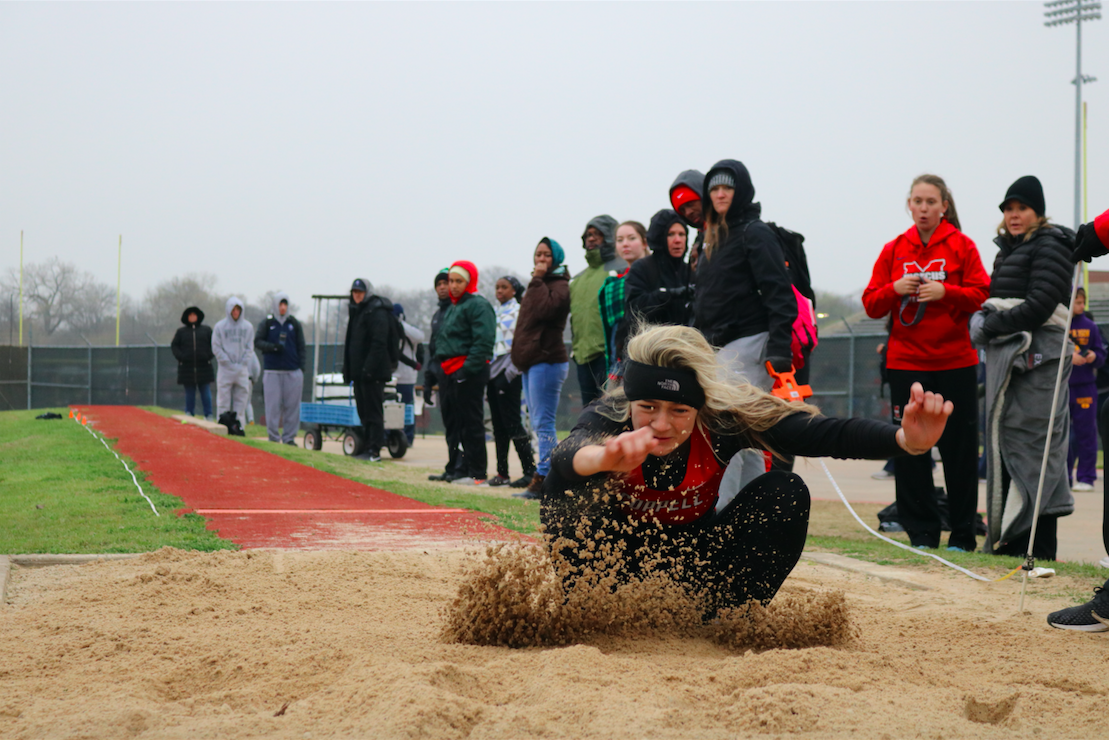 "Coppell High School junior Lauren Kellett jumps 18'4"" in long jump on Saturday, March 2 at Buddy Echols field, winning first place."