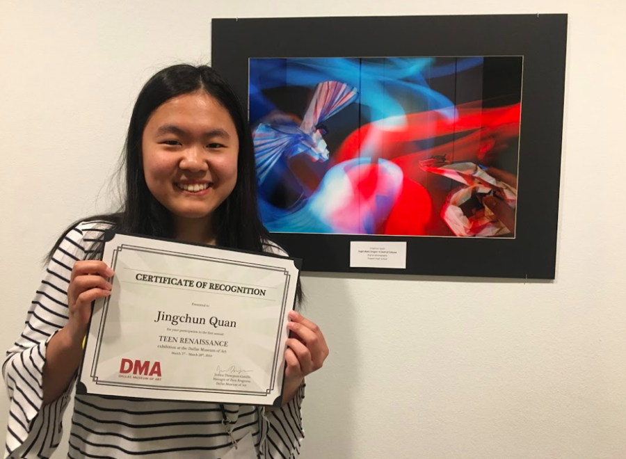 "Coppell High School senior Jingchun Quan displays her certificate in front of her artwork at the Dallas Museum of Art on March 16. Quan was chosen to showcase her artwork, ""Eagle Meets Dragon: A Clash of Cultures,"" through a festival hosted by the Dallas Museum of Art."