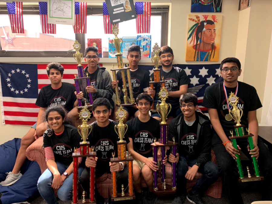 The Coppell High School chess club, lead by AP U.S. History teacher Scott Shelby, placed second and fifth at the annual Texas Scholastic Chess Championships in Houston from March 8-10. The nine students work together once a month to enhance their strategic thinking skills while playing chess. Photo taken by Lilly Gorman.