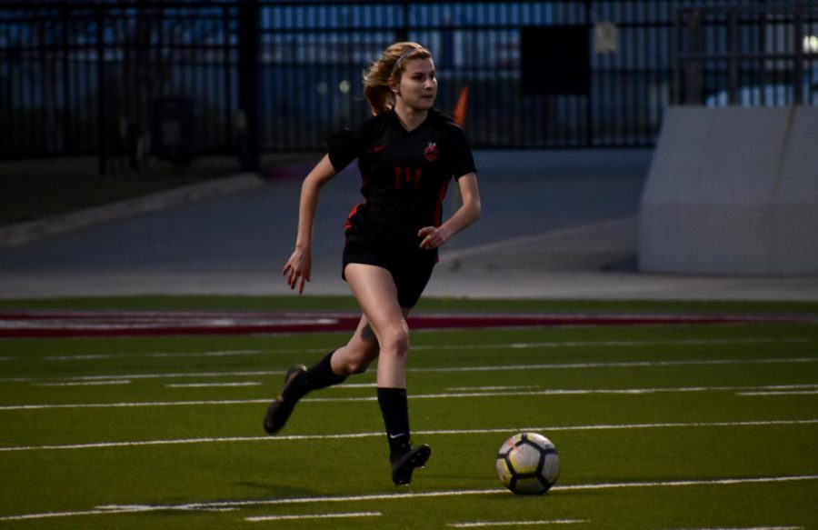 Coppell+senior+defender+Addison+Ramirez+looks+for+an+open+pass+during+the+game+against+Keller+on+Thursday+night+at+Northwest+ISD+Stadium.+The+Cowgirls+won%2C+3-0%2C+to+advance+to+the+Class+6A+Region+I+area+playoffs.