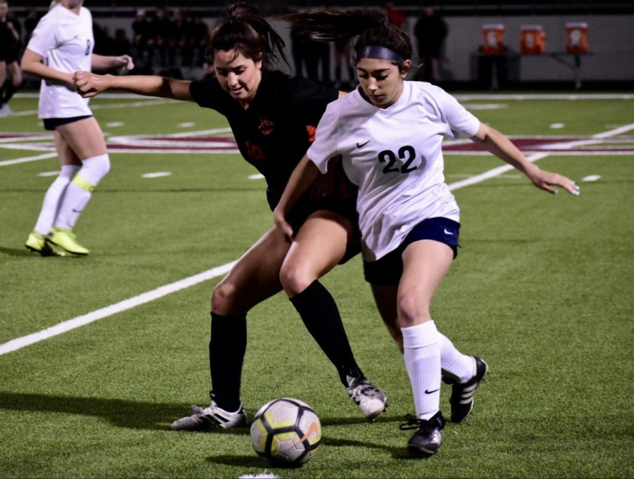 Coppell+junior+midfielder%2Fdefender+Montse+Lomeli+fights+for+the+ball+during+the+game+against+Keller+on+Thursday+night+at+NISD+Stadium.+The+Cowgirls+won%2C+3-0%2C+and+move+on+to+the+second+round+of+playoffs+as+bi-district+champions.