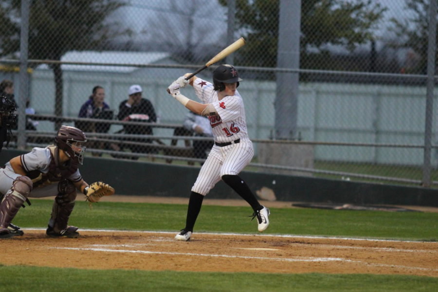Coppell junior catcher Hudson Polk doubles during the second inning against Lewisville on Friday at the Coppell ISD Baseball/Softball Complex. Cowboys beat the Farmers, 10-3.