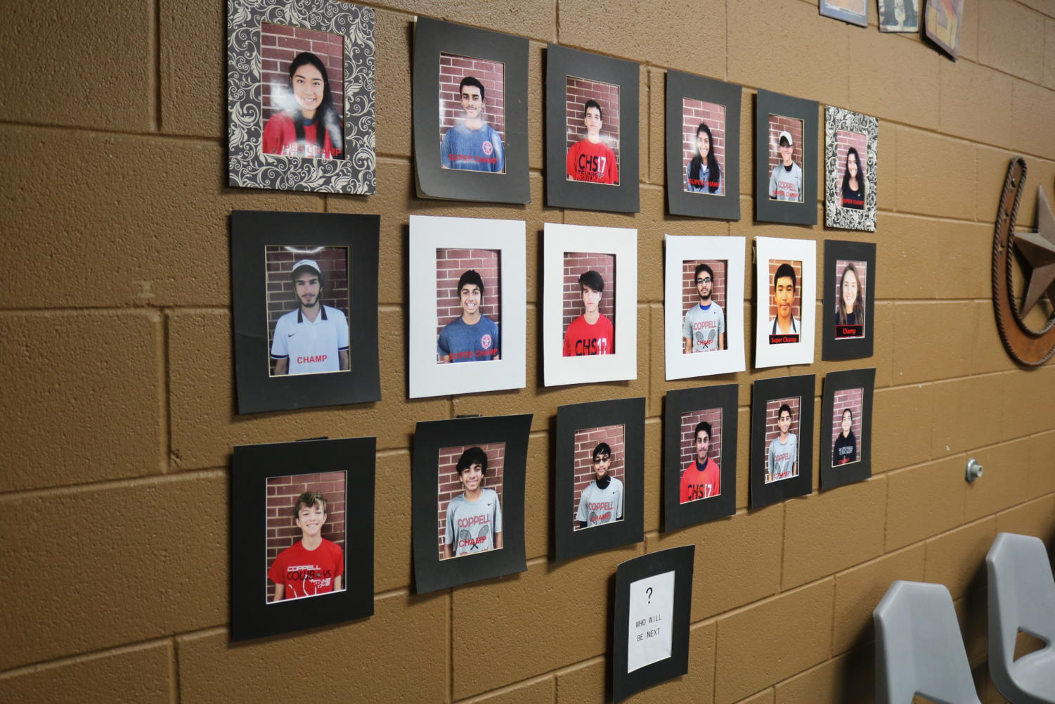 Coppell High School tennis players get framed pictures on the wall inside the CHS tennis center when they become champs or super champs. Tennis players become champs and super champs by winning a specific number of qualifying tournaments through the United States Tennis Association (USTA).