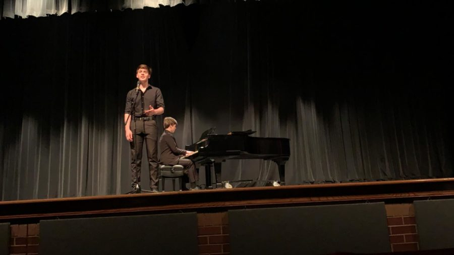 Coppell+High+School+juniors+Alex+and+Ryan+McCord+play+the+piano+and+sing+%E2%80%9CTill+I+Hear+You+Sing%E2%80%9D+from+Love+Never+Dies+which+earned+first+place+at+the+CHS+talent+show+in+the+auditorium+on+Saturday.+The+CHS+talent+show+allowed+students+to+show+off+their+skills+and+win+cash+prizes+by+placing+either+first+%28%24100%29%2C+second+%28%2450%29+or+third+%28%2425%29.+