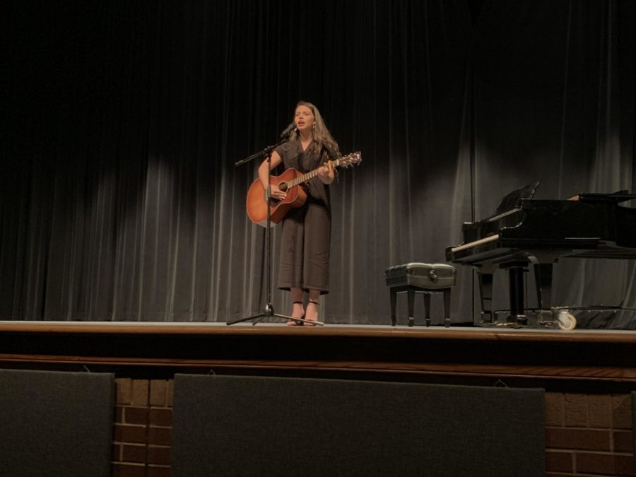 Coppell+High+School+freshman+Emma+Hoque+plays+the+guitar+and+sings+an+original+song%2C+%E2%80%9CSilence%E2%80%9D+at+the+CHS+talent+show+in+the+auditorium+on+March+30.+The+CHS+talent+show+allowed+students+to+show+off+their+skills+and+win+cash+prizes+by+placing+either+first+%28%24100%29%2C+second+%28%2450%29+or+third+%28%2425%29.+