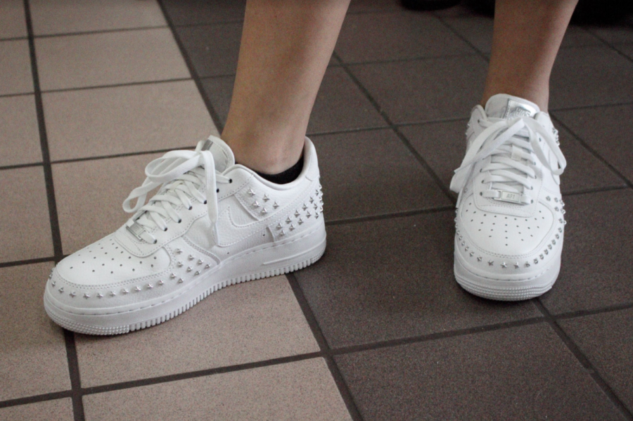 Coppell High School sophomore Paulina Morlett wears silver star studded Nike Air Force 1 sneakers on Tuesday. Recently at CHS, students have been following the chunky dad sneaker trend seen on the internet.