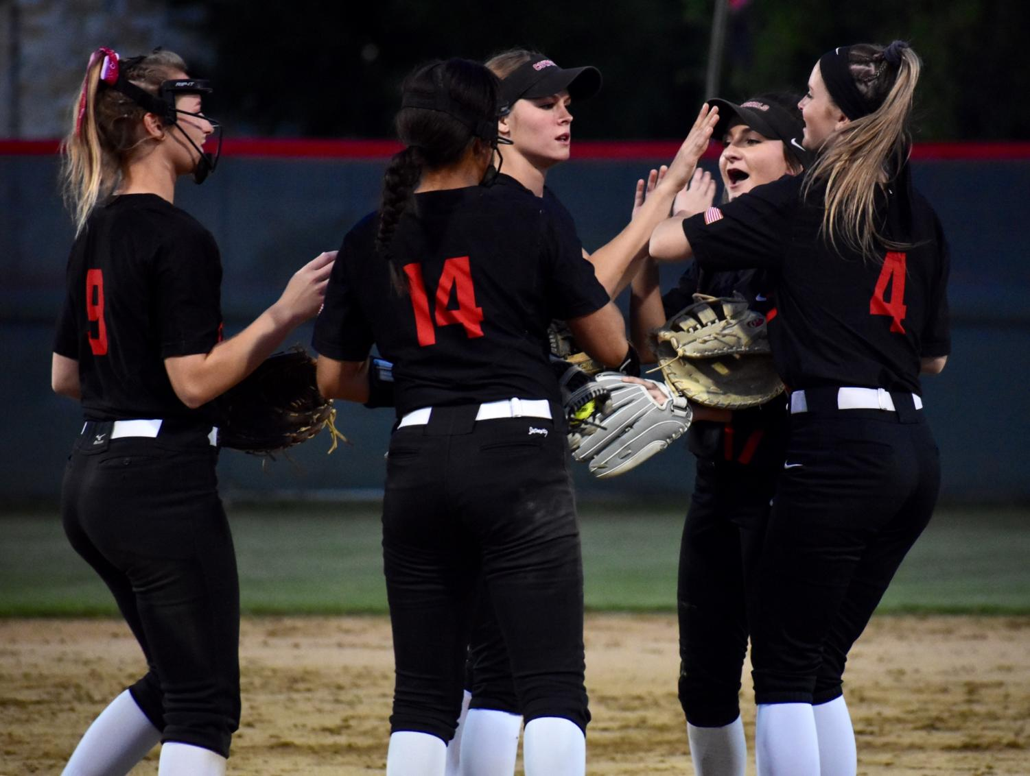 After+scoring+their+first+home+run%2C+Coppell+players+celebrate+at+the+game+against+Keller+at+the+Colleyville+Heritage+High+School+on+Friday.+The+Cowgirls+lost%2C+5-2%2C+as+their+season+ended+in+the+first+round+of+playoffs.
