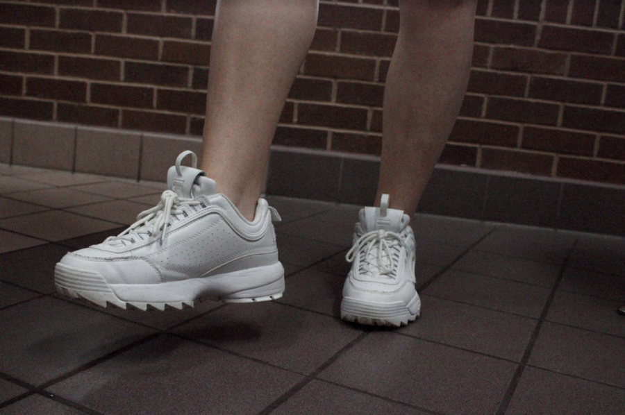 Coppell+High+School+sophomore+Katy+Hinkle+wears+chucky%2C+all-white+Filas+on+Tuesday.+Recently+at+CHS%2C+students+have+been+following+the+chunky+dad+sneaker+trend+seen+on+the+internet.