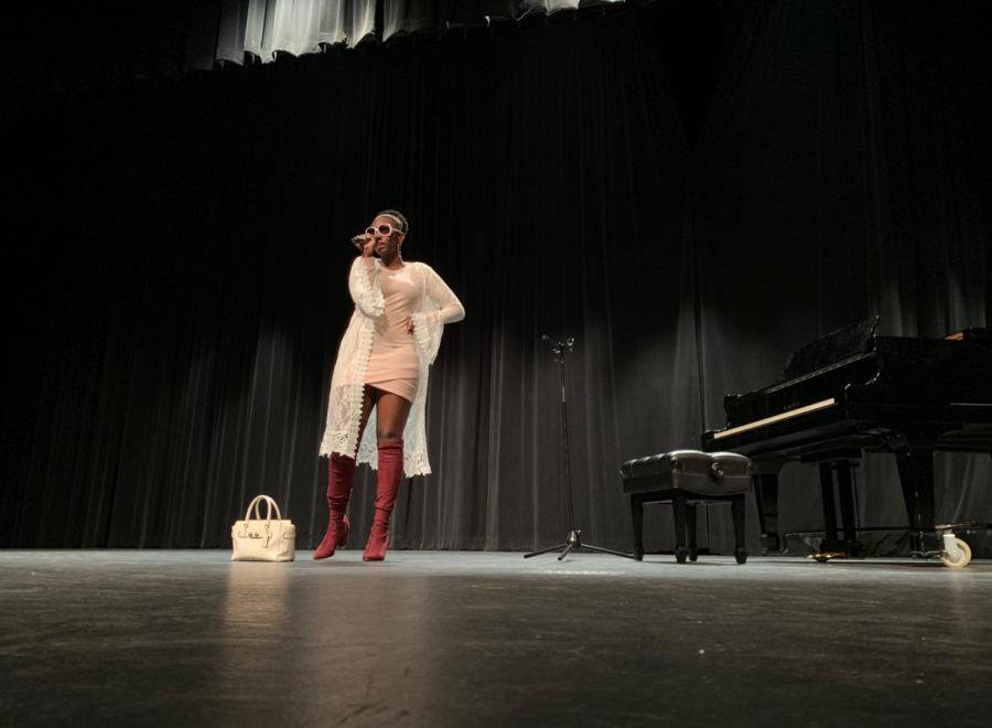 "Coppell High School sophomore Jadalyn Van sings ""7 Rings"" by Ariana Grande at the CHS talent show in the auditorium on Saturday. The CHS talent show allowed students to show off their skills and win cash prizes by placing either first ($100), second ($50) or third ($25)."