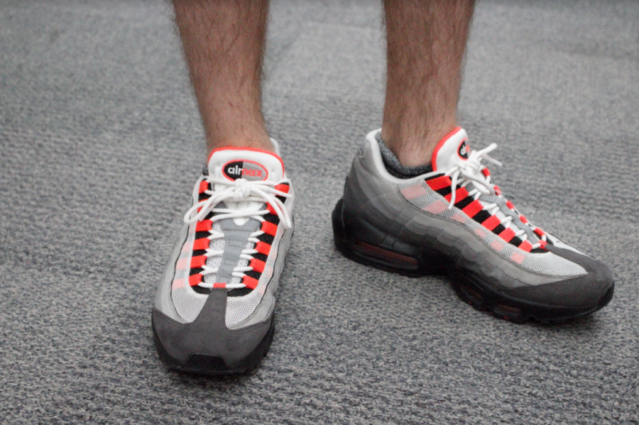 Coppell+High+School+senior+Jake+McCann+wears+bright+orange+Nike+Airmax+tennis+shoes+on+Tuesday.+Recently+at+CHS%2C+students+have+been+following+the+chunky+dad+sneaker+trend+seen+on+the+internet.