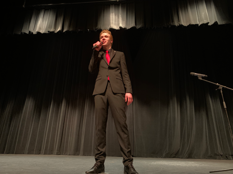 Coppell+High+School+senior+Barrett+Engler+is+an+MC+for+the+CHS+talent+show+in+the+auditorium+on+Saturday.+Ingler+and+his+co-MC+CHS+senior+William+Leslie+introduce+each+act+for+the+judges+with+a+quirky+pun.+