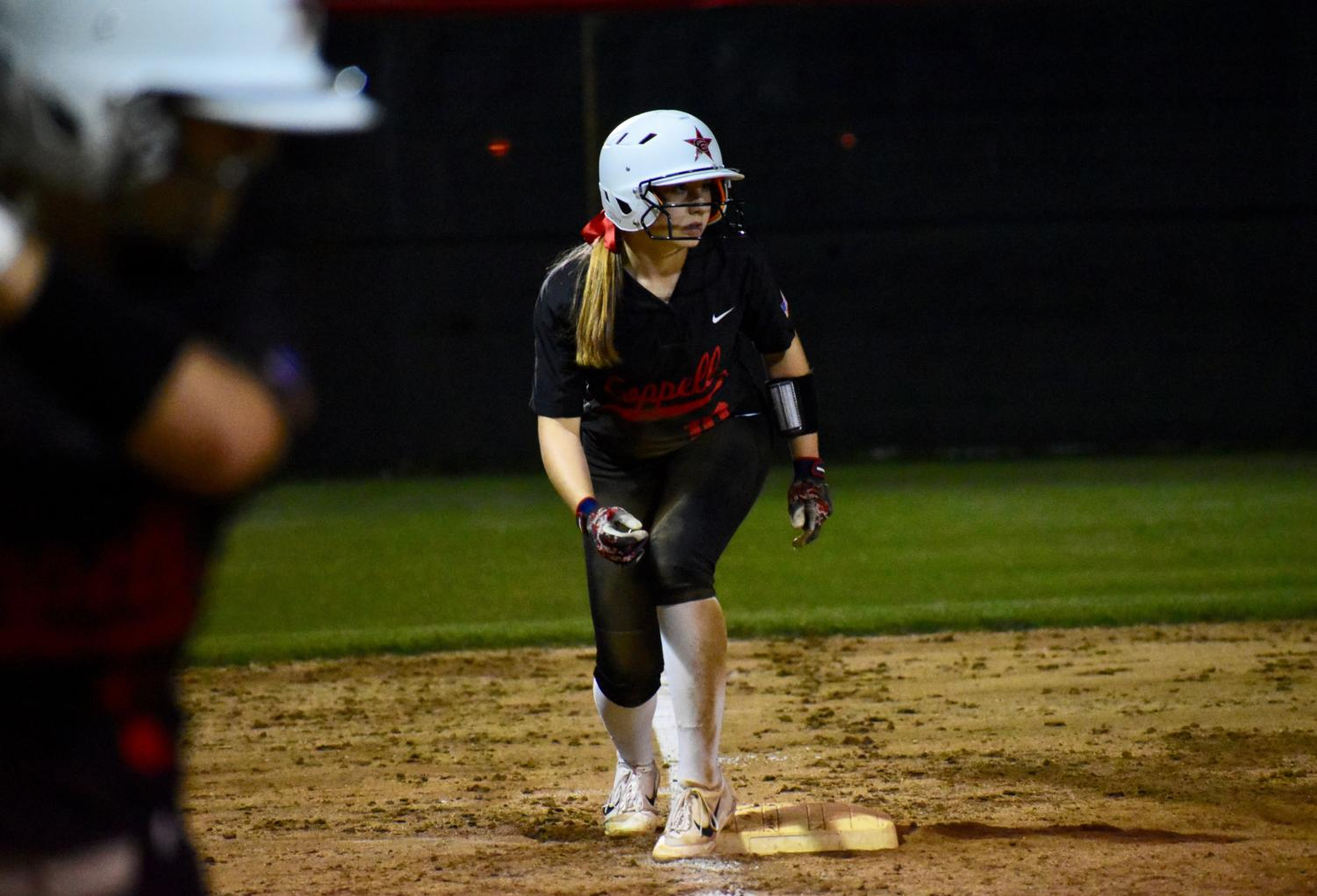 Coppell+senior+catcher+Kaitlyn+O%E2%80%99Quinn+leads+off+third+base+at+the+game+against+Keller+at+the+Colleyville+Heritage+High+School+on+Friday.+The+Cowgirls+lost%2C+5-2%2C+as+their+season+ended+in+the+first+round+of+playoffs.
