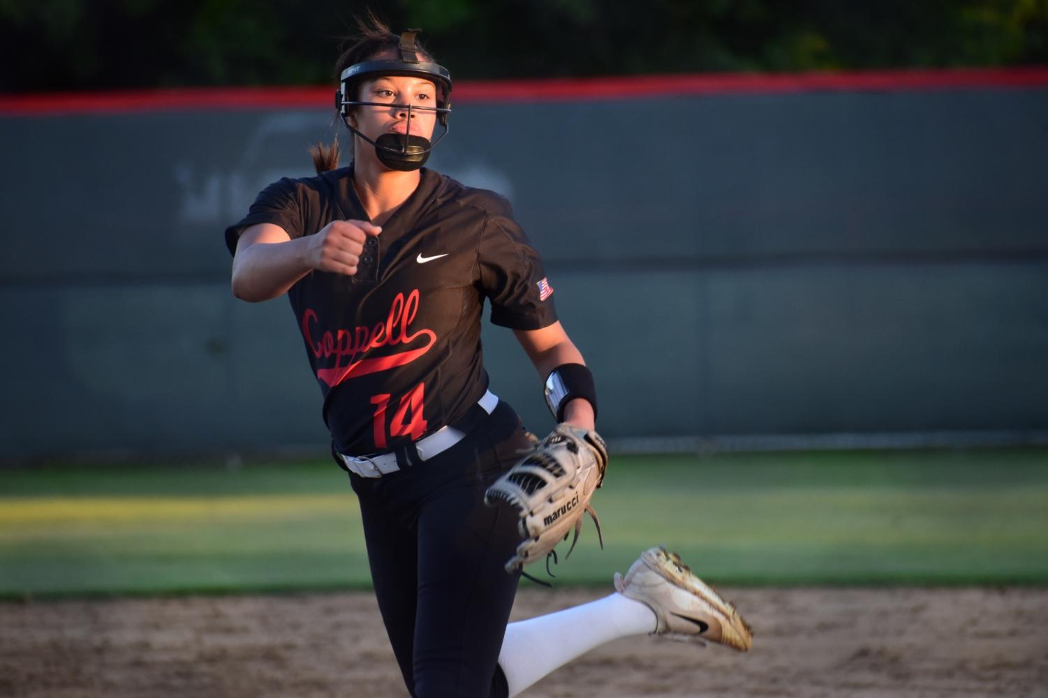Coppell senior pitcher/centerfielder Nora Rodriguez pitches the ball to her opponent at the game against Keller at the Colleyville Heritage High School on Friday. The Cowgirls lost, 5-2, as their season ended in the first round of playoffs.