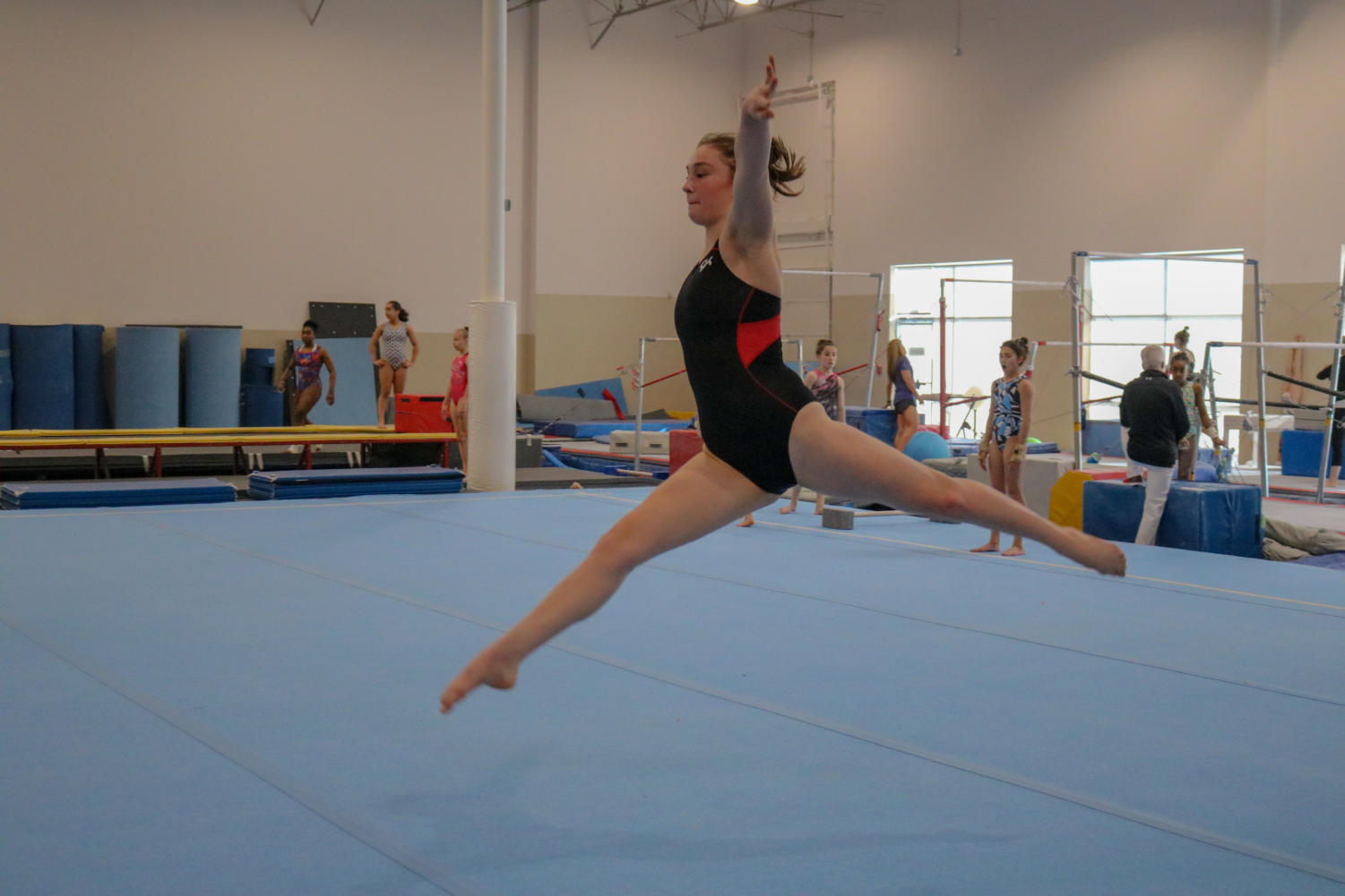 Coppell High School sophomore Tallulah Rushton practices her routine at Texas Dreams Gymnastics on March 18. Tallulah heads to the gym from 7 a.m. to 11 a.m., and her training consists of conditioning, vault, beams and floor.
