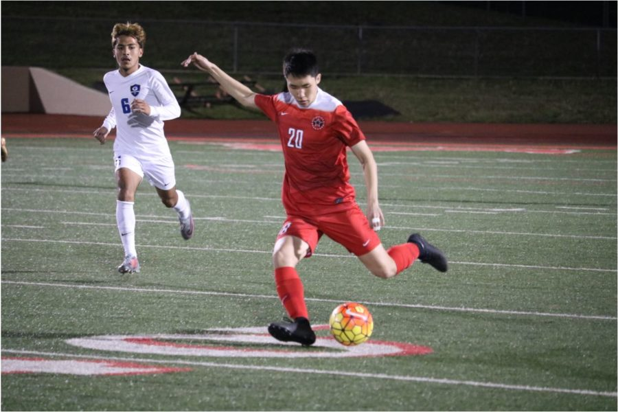 Coppell defensive Dail Kang passes the ball upfield  during the match against Grand Prairie at Mustang-Panther Stadium on Tuesday. The Cowboys lost, 3-1, in second round of bi-district playoffs.