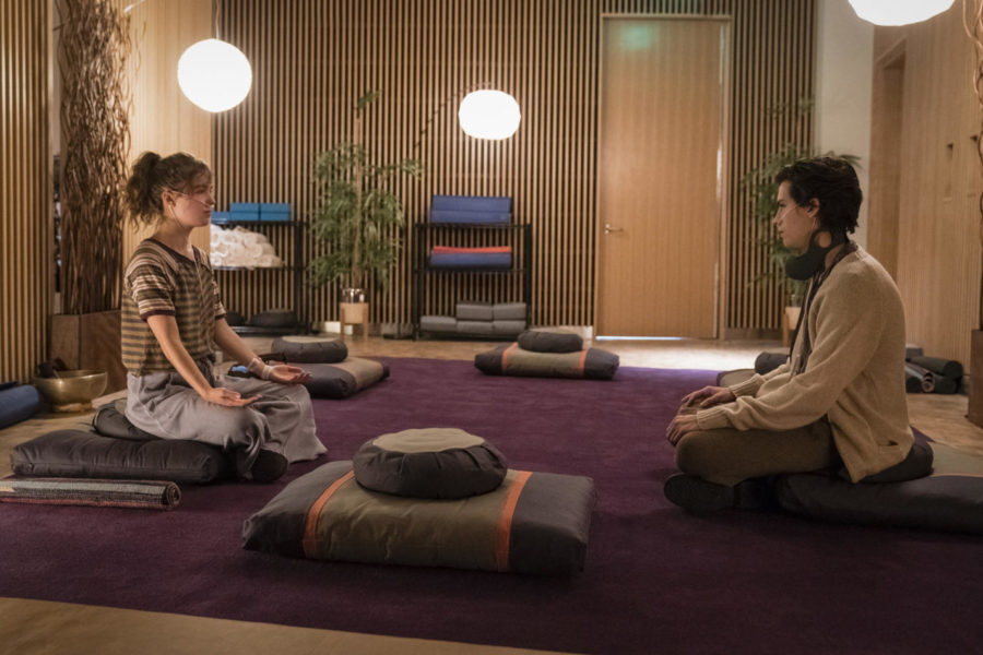 Stella Grant (played by Haley Lu Richardson) and Will Newman (Cole Sprouse) do breathing exercises and meditation together in Five Feet Apart, released March 15. Five Feet Apart follows two teens who share a romantic bond, but cannot touch each other due to the nature of cystic fibrosis, a disorder they both have.