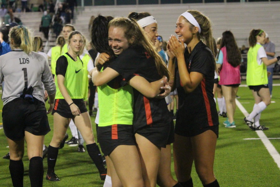 Coppell+senior+forward+Rebecca+Watley+and+junior+midfielder+Margaret+Roberts+get+emotional+after+the+Cowgirls+were+eliminated+from+the+playoffs+at+Broncos+Field+on+Friday.+Carroll+defeated+Southlake+Coppell.%2C+3-1.+