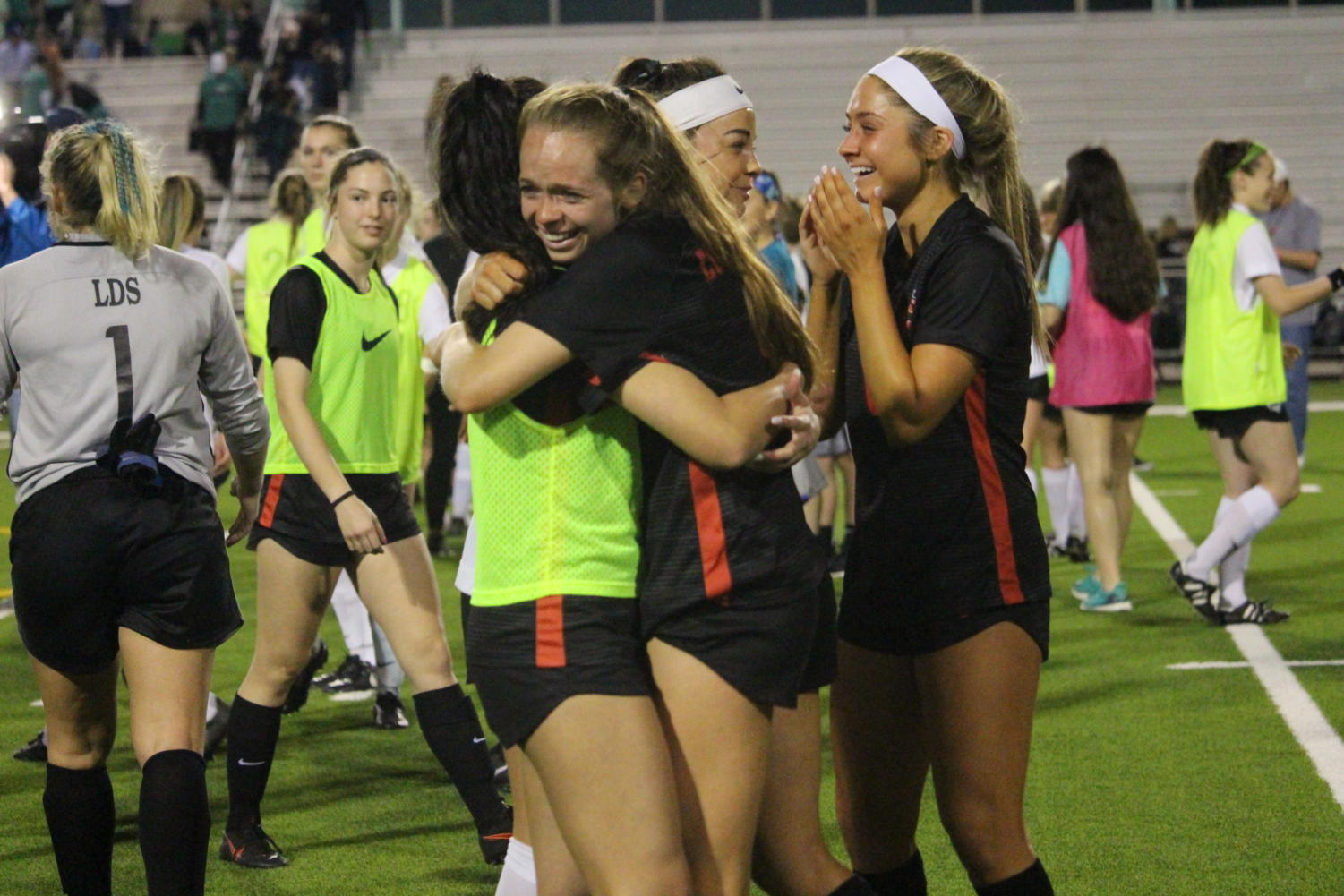 Coppell senior forward Rebecca Watley and junior midfielder Margaret Roberts get emotional after the Cowgirls were eliminated from the playoffs at Broncos Field on Friday. Carroll defeated Southlake Coppell., 3-1.
