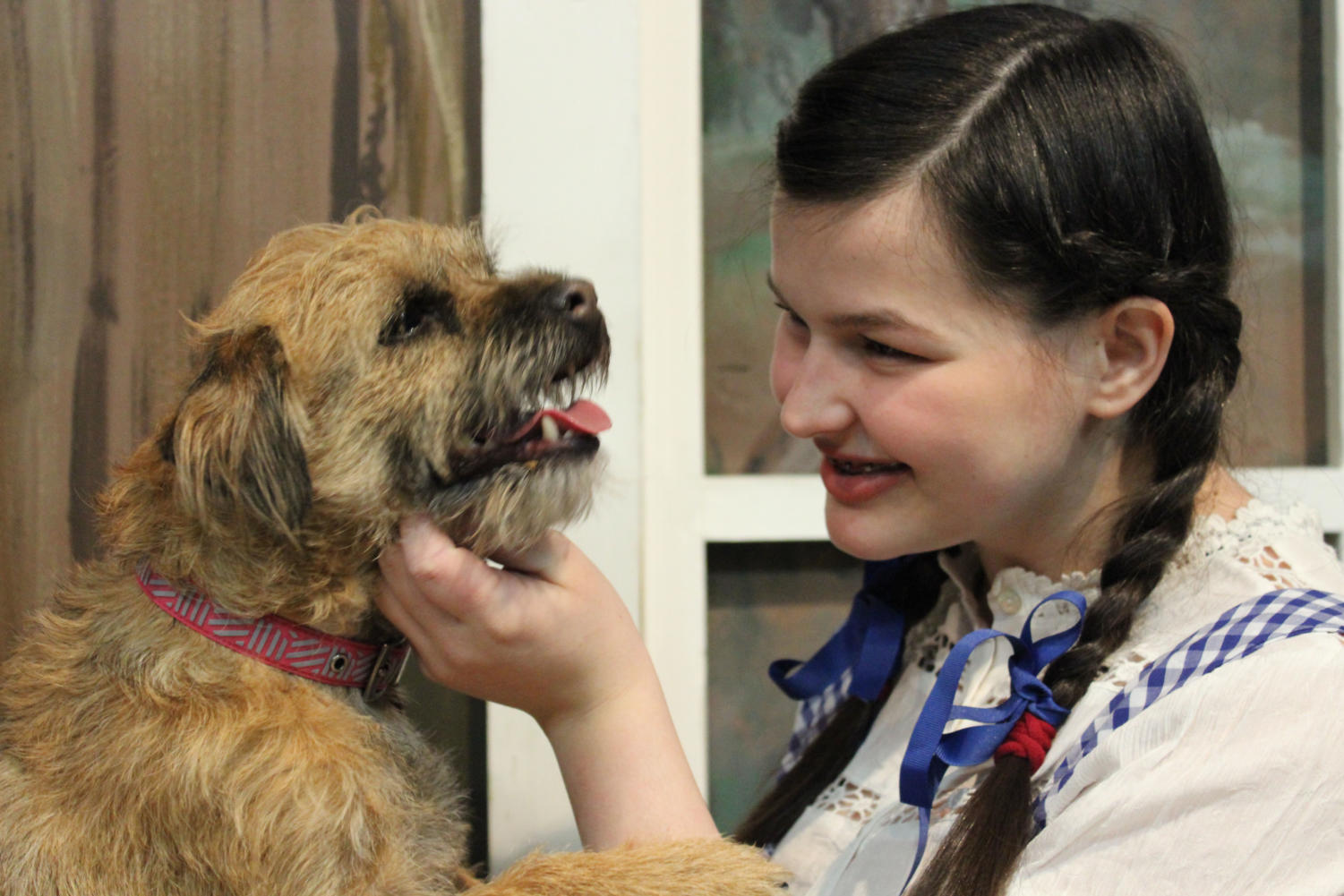 "In Theatre Coppell's show ""The Wizard of Oz"", Dorothy (played by Bella Bollack), pets her dog, Toto. Theatre Coppell's second set of ""The Wizard of Oz"" performances are this weekend, starting Friday at 8 p.m."