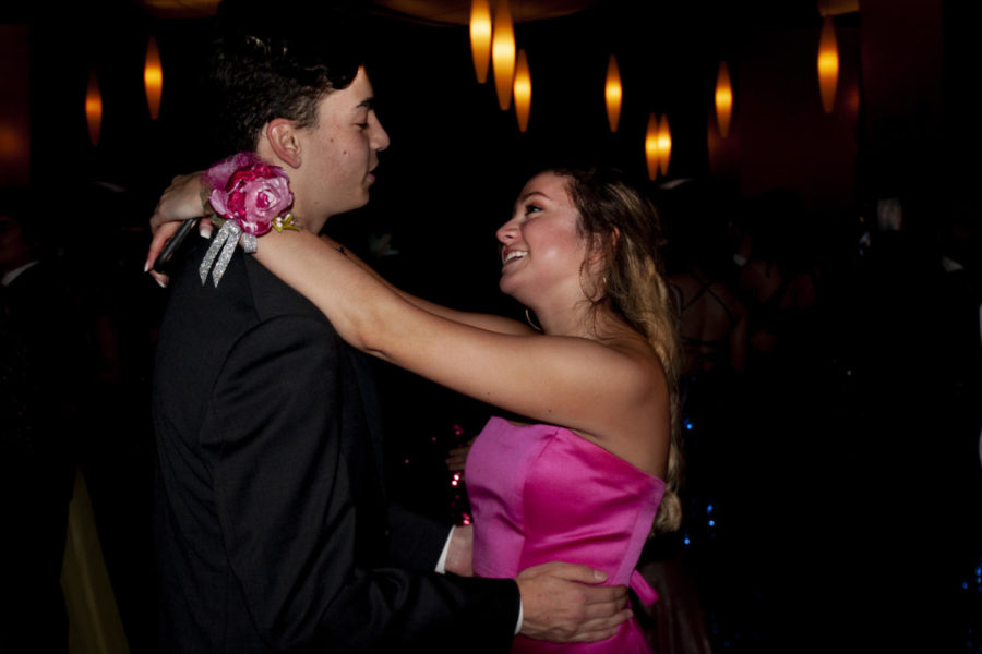 Coppell High School senior Mia Cozzarelli dances with 2018 CHS graduate Clinton Campbell at prom. CHS Prom 2019 was held at AT&T Stadium in Arlington on Saturday, as students danced, enjoyed snacks and played mock casino games during the dance.