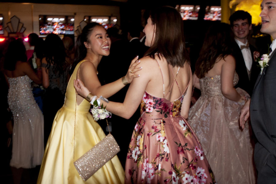 During prom, Coppell High School senior Miyabi Zaizen greets her friend and fellow Lariette, CHS senior Madeleine Haydek. CHS Prom 2019 was held at AT&T Stadium in Arlington on Saturday, as students danced, enjoyed snacks and played mock casino games during the dance.