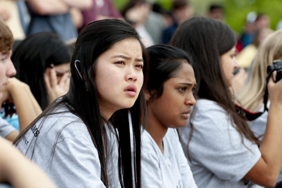 Coppell High School junior Daphne Pham watches the mock Shattered Dreams accident on Thursday in the parking lot. Shattered Dreams is held every two years and is intended to show students the effects of drunk driving.