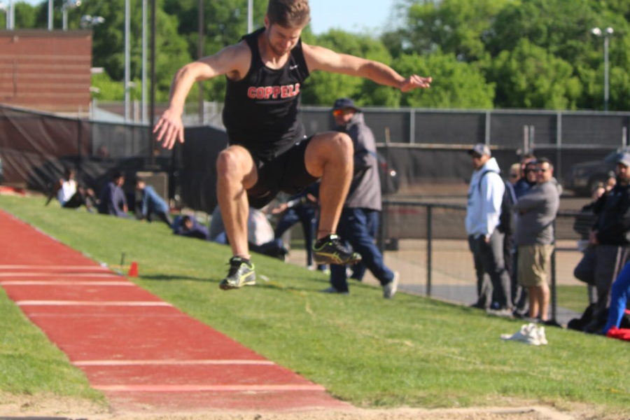 Boys track runs down district championship with area meet looming