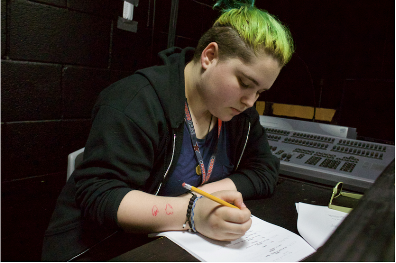 "Coppell High School junior Ashlyn Peterman writes cues for her next stage managing project, the upcoming ""Senior Showcase"" on May 3-4 at the CHS auditorium. Peterman hopes to pursue a career in managing or stage makeup."