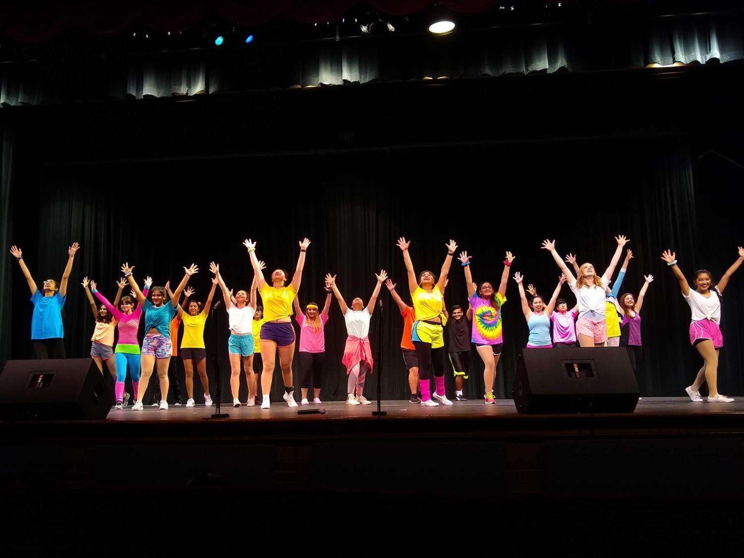 """Vivacé! members finish the final song, """"We Got The Beat/You Can't Stop The Beat"""", at the """"We Are Family"""" show on Saturday at CHS auditorium. The Vivacé! members performed a variety of songs about togetherness and the power of love."""