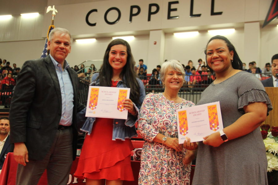 Coppell+High+School+seniors+Jimena+Benavides+and+Genesis+Agyemang+receive+scholarships+for+their+achievements+and+community+service+at+the+class+of+2019+senior+awards+in+the+CHS+arena.+Yesterday%2C+CHS+students%2C+faculty+and+parents+were+invited+to+congratulate+this+year%27s+seniors+for+earning+awards+and+scholarships.
