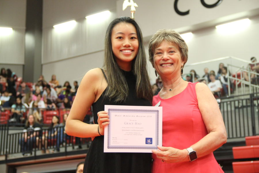 Coppell+High+School+senior+Grace+Hao+receives+a+scholarship+to+the+University+of+Pennsylvania+at+the+class+of+2019+senior+awards+in+the+CHS+arena.+Yesterday%2C+CHS+students%2C+faculty+and+parents+were+invited+to+congratulate+this+year%27s+seniors+for+earning+awards+and+scholarships.